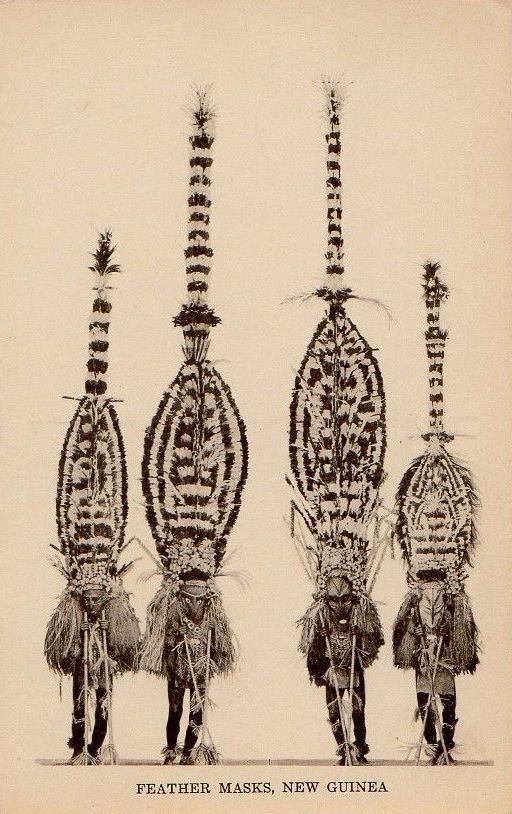 the-two-germanys:  Feather masks, New Guinea.Postcard, Australia.