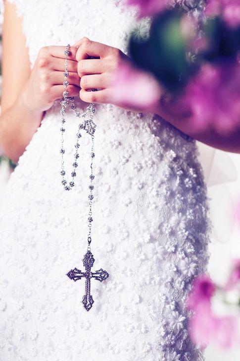 lovely.  her wedding dress fabric detail is stunning!!  catholic wedding rosary
