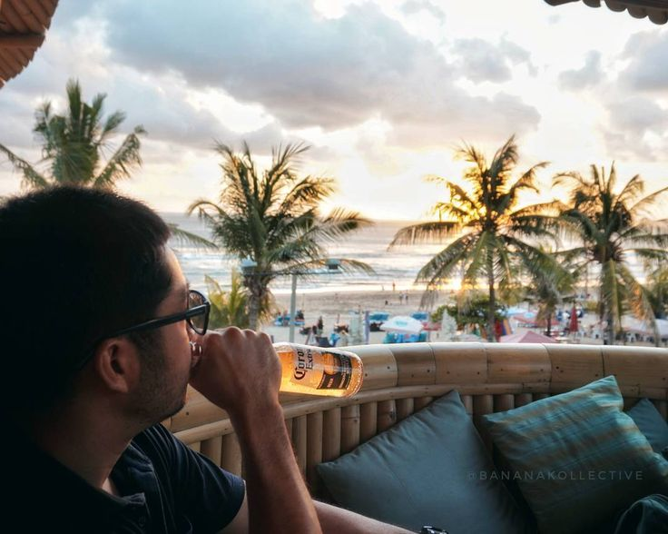#Bali. Enjoying sunset with a bottle of cold @Corona beer at @AzulBeachClub is just another ordinary day in Bali