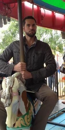 Zachary Levi - riding a carousel as manly as possible.