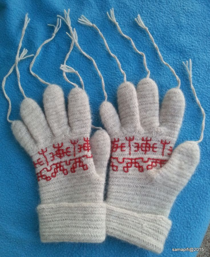 Needlebound / nalbound gloves with Carelian embroidery details, tassels at the finger tips inspired by church mittens that were not supposed to be used for working (ie on a Sunday). Made with Finnish Villa Laurila's angora rabbits yarn using the Finnish Stitch 2+2, UUOO/UUOOO F2, by Sanna-Mari Pihlajapiha. Posted [in Finnish & English] 2015-12-26 in her blog Väkerrystä - Dabbling in Nalbinding. Please see link for more info and photos!