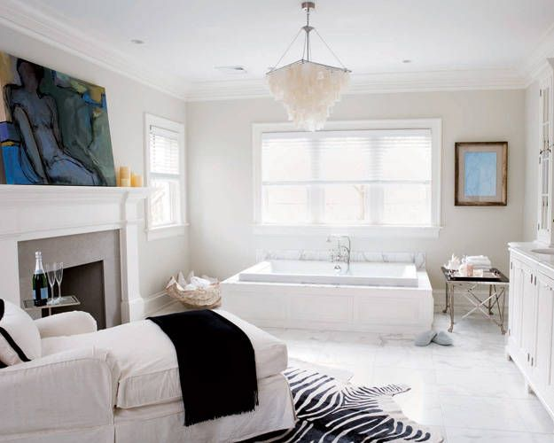 cozy couch in a gorgeous white bathroom