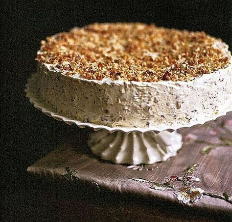 This elegant Austro-Hungarian Hazelnut Torte recipe is made with a nut sponge cake filled with caramelized almond whipped cream.