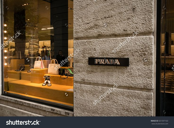 Milan, Italy - October 8, 2016: Window and entrance of a Prada shop in Milan - Montenapoleone area, Italy. Few days after Milan Fashion Week. Fall Winter 2017 Collection.