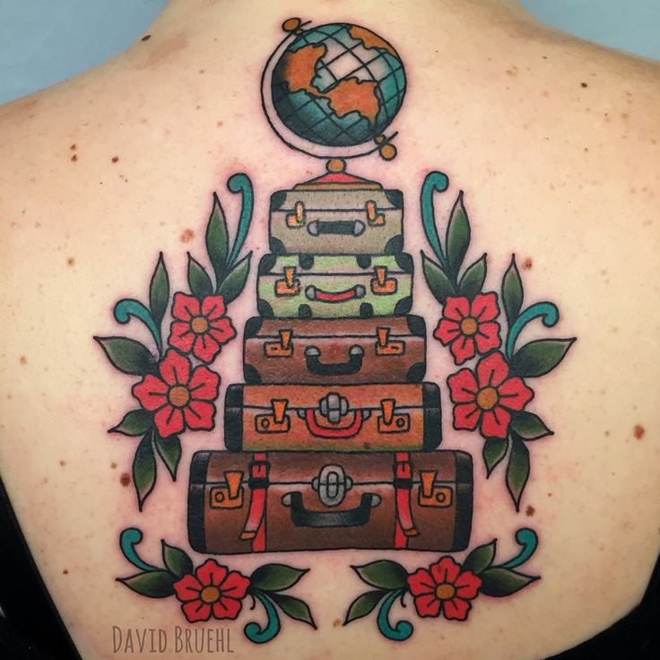 Vintage style luggage, suitcases and globe with flowers. Traditional color travel back tattoo by David Bruehl. www.davidbruehl.com