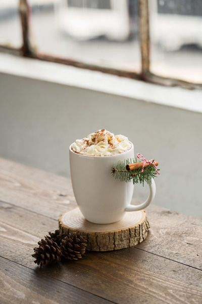 Make an ordinary mug festive for the holidays with a bit of pine and a stick of cinnamon!