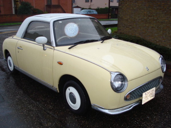 pale yellow Nissan Figaro