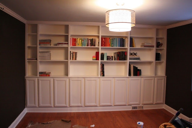 Built in bookcases they used pre fab cabinets for the for Pre built cupboards