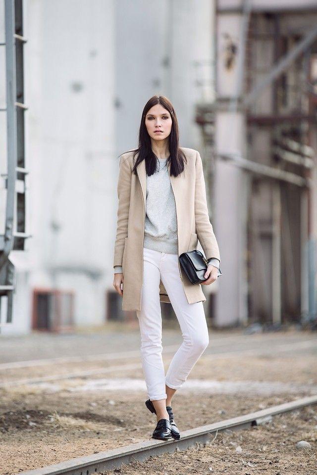 white pants, grey sweater, beige coat, black pouch