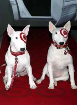 Bullseye (left) poses with his wax figure (the first animal ever immortalized in wax) at Madame Tussauds in New York