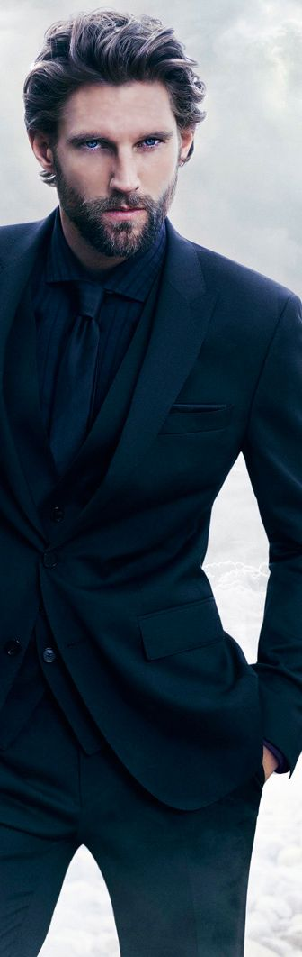 dark suits with dark shirts and ties make you look like a villian, this guy is totally trying to kill james bond
