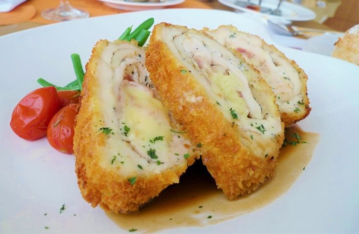 """Dish of the Week: Chicken Cordon Bleu  From classic comfort foods to regional standouts and desserts, we'll be sharing a new recipe with you each week. Find other dishes of the week here. This week, in honor of National Cordon Bleu Day on April 4 (because yes, that's a real thing), we're sharing a recipe for the dish. Meaning """"blue ribbon"""" in French (in reference to the ribbons worn by the highest order of knighthood), cordon bleu is a preparation of meat-usually chicken..."""