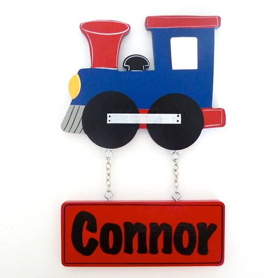 Kids train door sign. Fun and colourful custom name signs look fantastic displayed on your childs door, bedroom or play rooms. These personalised baby name signs make a wonderful new baby gift. Door signs can be painted to better suit your nursery decor. Each door plaque is personalised and hand painted just for you. Door sign are varnished for added protection. This also allows the plaque to be easily wiped cleaned with a damp cloth. This listing is for dinosaur door Sign/Plaque. Motif ...