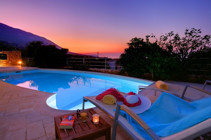 The pool area at Villa Petalida has the most amazing sunset views!