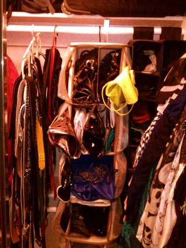 Closet organization I used a scarf organizer to organize all my belts then I found a purse carousel. The sides are all purses, turn it around and there's pockets for all my chunky bracelets. I found two hanging shoe storage organizers for my flip flops. Lastly, I used another scarf organizer to store all my scarves. Above all the storage I placed another curtain rod and put all of my hangers up and out of the way for when not in use.