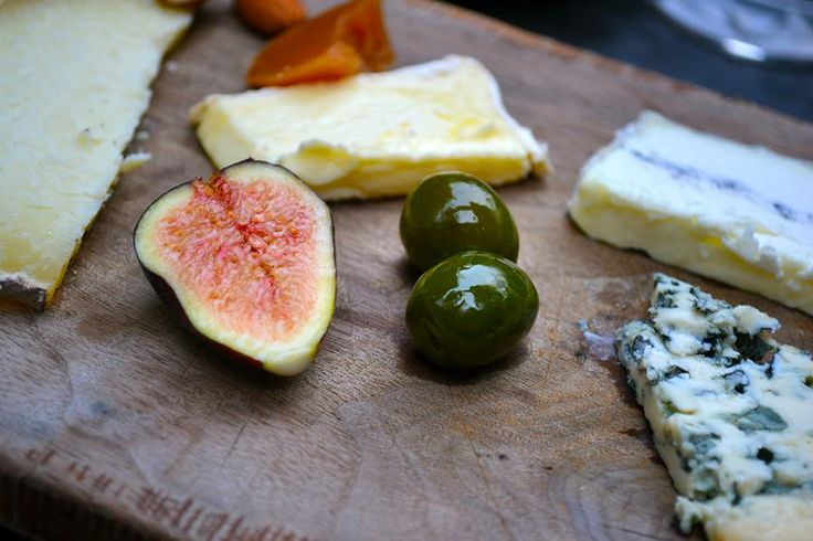 One of my favorite photos from a special romantic moment. Fig, green olives, cheese, guava preserves, honeycomb.