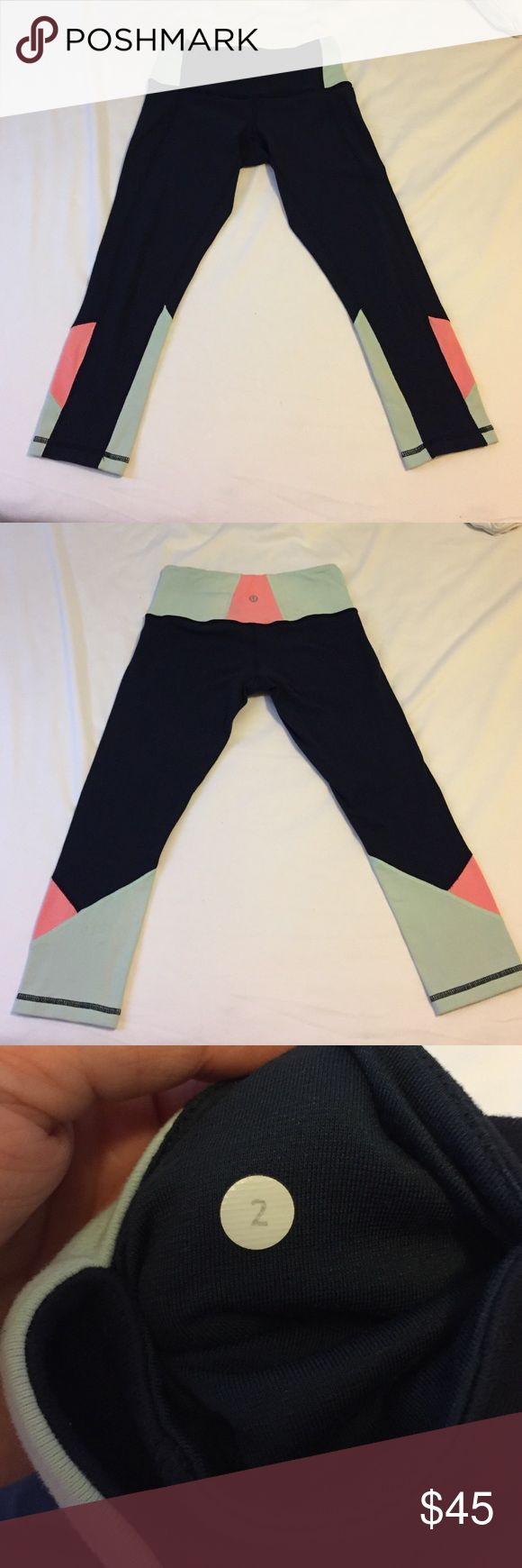 🔸1 HOUR SALE🔸Navy LuluLemon Leggings Navy, mint and peach colored LuluLemon leggings. Size 2 in good condition! Slight wear on the crotch region but other than that no issues :) cheaper on merc. lululemon athletica Pants Leggings