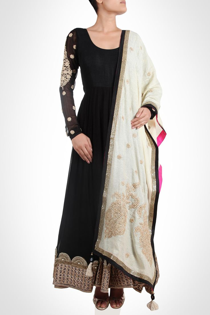 Aksh - Elegance oozes out of this gorgeous black anarkali. Thick gota lace along with kundan work adorns the hemline, while intricate thread work adds charm to the long sleeves. Ivory dupatta with beige thread work and a combination of borders completes the attire. SHOP NOW: www.kimaya.in