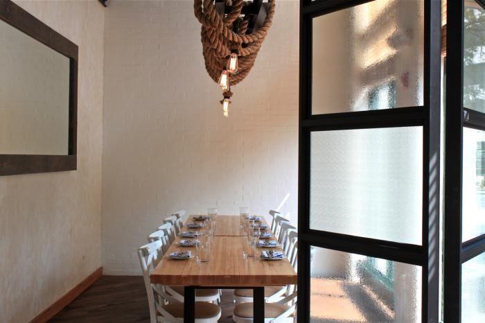 A Hose Factory Transformed: West Bridge Restaurant in Boston : Remodelista: Great idea for a folding Door.