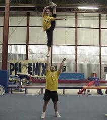 One man cheer stunt bow and arrow | Cheer | Pinterest