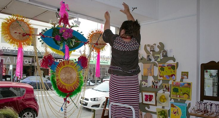 Jen Denzin adjusting her creation inspired by Torres Straight Island festivals and Chinese Festivals. See at Nanshe studio gallery until January 2016