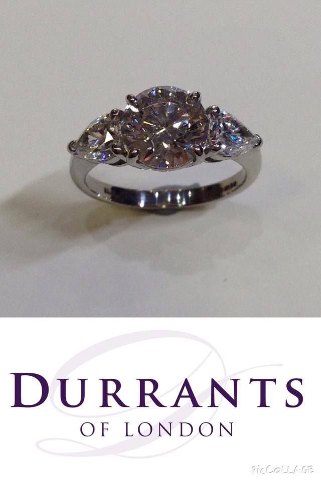 18ct white gold three stone diamond ring set with one 2.01ct G Si1 round GIA and a matching pair of pear shape diamonds