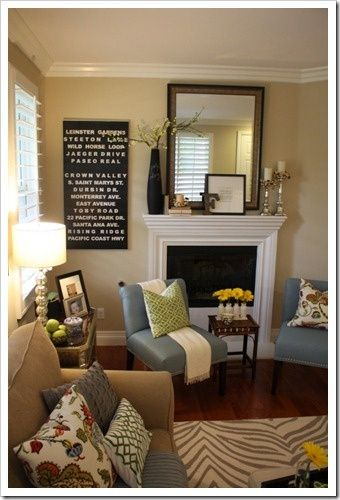 Small living room space fireplace green yellow and blue for Accent colors for neutral rooms