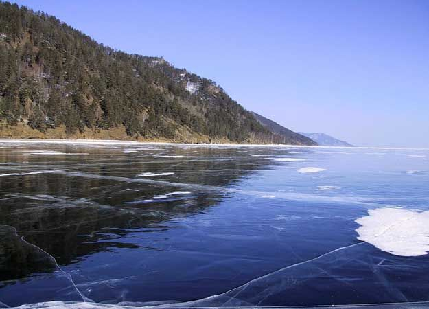 Lake Baikal, Southeast Siberia is the oldest, deepest lake in the world, reaching depths of 5,577 ft. - more than a mile!