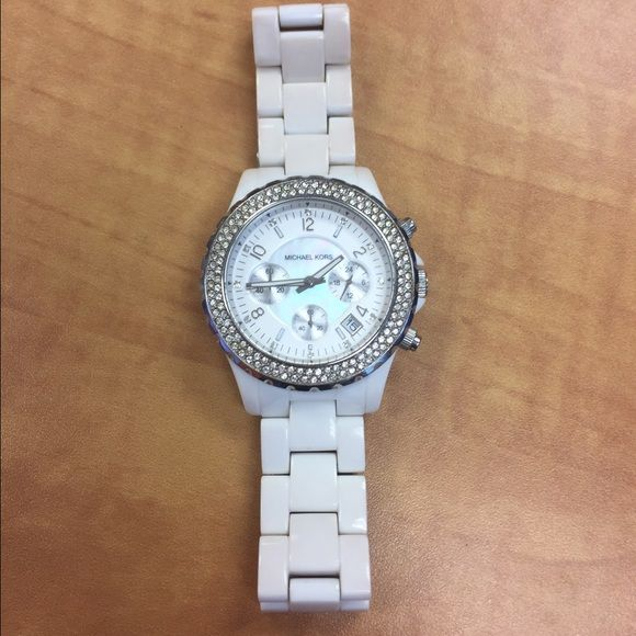 **LOWEST PRICE**White Michael Kors Watch Authentic Michael Kors White ceramic watch with rhinestones around the center. Needs a new battery and needs to be cleaned (see last picture). Fake tanner stained it but a jeweler can easily remove it.Perfect condition otherwise  Michael Kors Accessories Watches