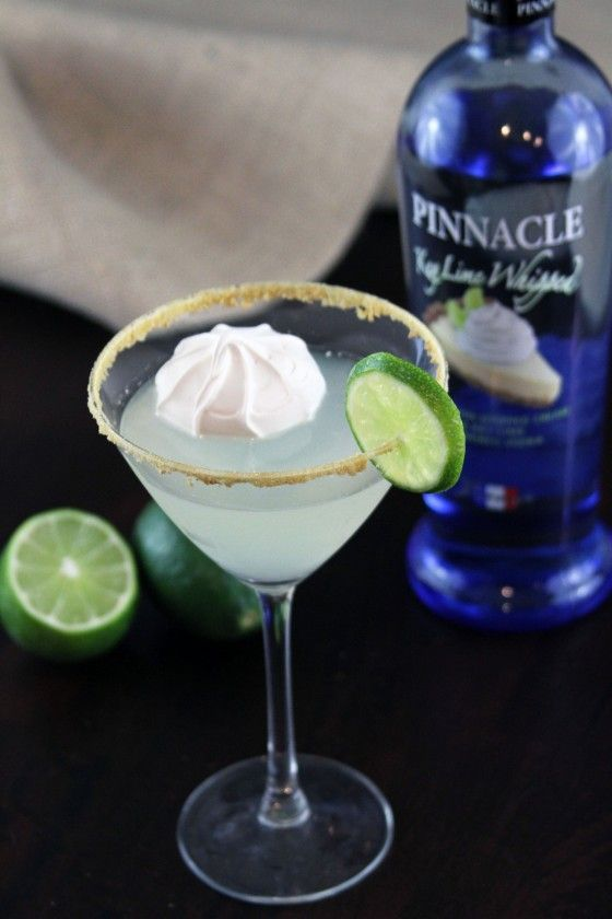 Key Lime Pie Martini :: 2 tablespoons graham cracker crumbs,  1 tablespoon sugar,  2 ounces Pinnacle Key Lime Whipped Vodka,  1 ounce simple syrup,  1 ounce triple sec,  1 ounce lime juice