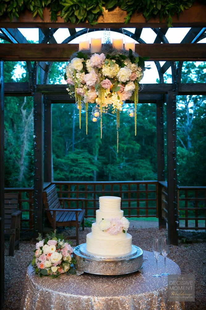 Foral chandelier over the cake at Barnsley Gardens: photo by The Decisive Moment