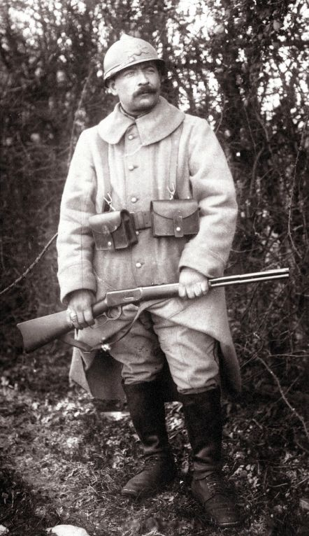 "WWI. French soldier with ""Mousqueton Winchester"" M1894 .30-30 carbine c.1915~17.  The Winchester M94 was purchased in 1914 by the French army - along with many other modern American firearms throughout the war- to equip truck, plane and later tank pilots."