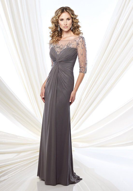 Stretch mesh and tulle slim A-line gown with hand-beaded illusion three-quarter sleeves and bateau neckline, sweetheart bodice with twisted center, beaded illusion keyhole back, sweep train.