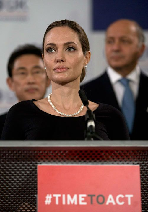 Angelina Jolie dons black dress and pearls while speaking at G8 meeting #celebrity #pearls
