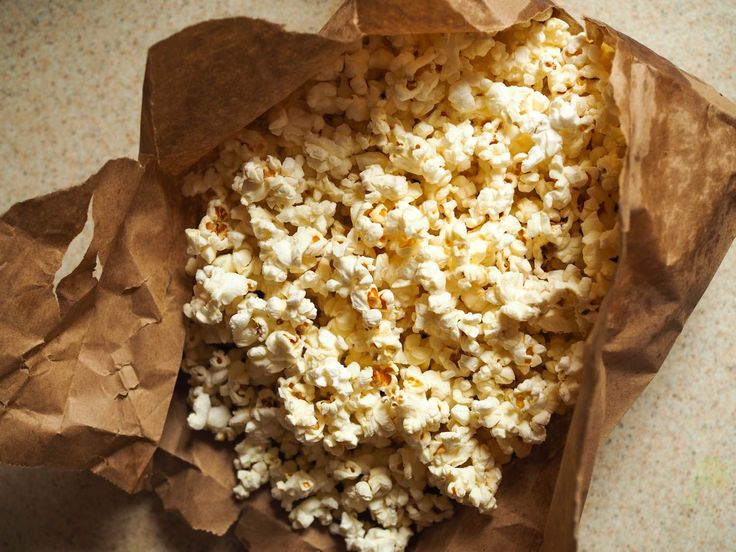 You can make your own microwavable popcorn in a brown paper lunch bag.