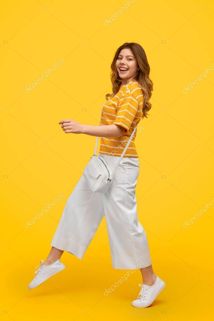 Stylish Young Woman Walking And Smiling Stock Photo Aff