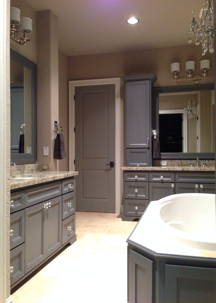 Grey master bathroom dark grey cabinets with bianco for Perfect kitchen and bath quincy