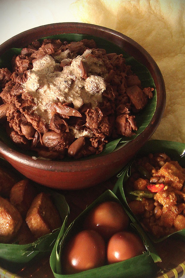 GUDEG. ( is a sweet young jackfruit dish usually served with rice, egg, chicken, Tofu and Tempeh sambal and crunchy beef skin (Krecek), Traditional food from Yogyakarta, Indonesia ). #PINdonesia