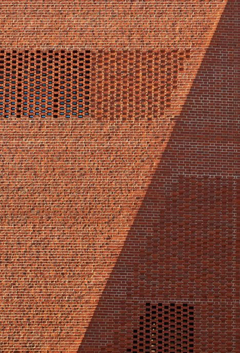 Masses of stepped flemish and mesh bond brick work from Irish Architects O'Donnell + Tuomey at the new London School of Economic Student Cen...