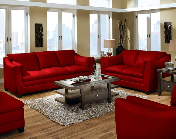 Bright red sofas, black and white area rug... DEFINATELY a possibility for us, our house colors are black,red and white <3 Contemporary,neat look with a pop of color <3