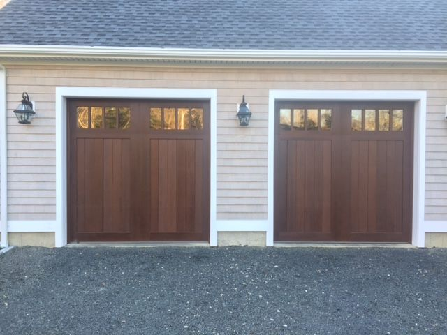 17 best images about clopay faux wood garage doors on for Wood grain garage doors