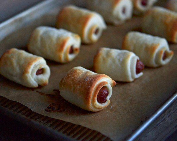 """""""It's hard not to appreciate the beauty of a simple weenie wrapped in pizza dough. Who can resist? After much, much too much trial and error for such simple fare, I have concluded that wrapping the pigs in triangle-shaped dough is way overrated."""" — Nicole Hunn of Gluten-free on a Shoestring"""
