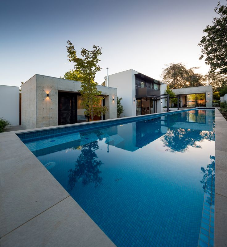 Modern architecture, off-form concrete, swimming pool.  By Collins Caddaye Architects, Canberra.  Photographed by Stefan Postles, Chalk Studio.