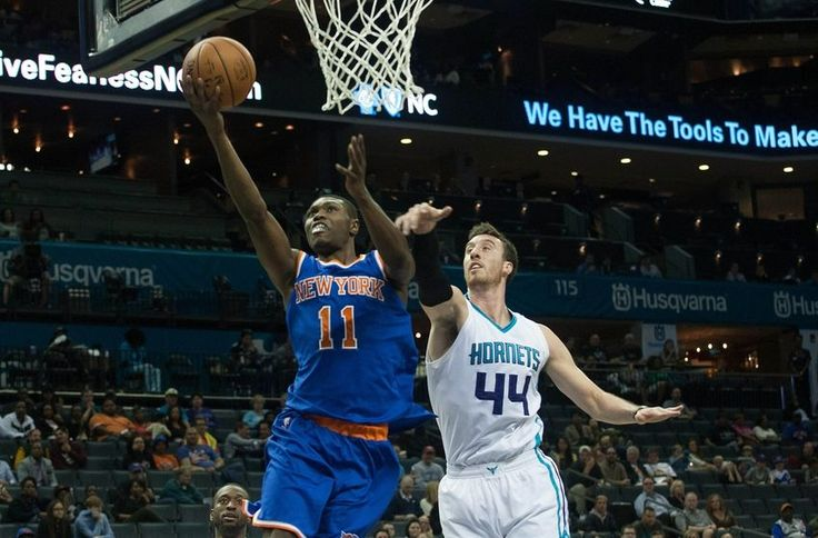 Oct 17, 2015; Charlotte, NC, USA; New York Knicks forward Cleanthony Early (11) goes up for a shot while Charlotte Hornets center Frank Kaminsky III (44) defends during the first half at Time Warner Cable Arena. Mandatory Credit: Jeremy Brevard-USA TODAY Sports