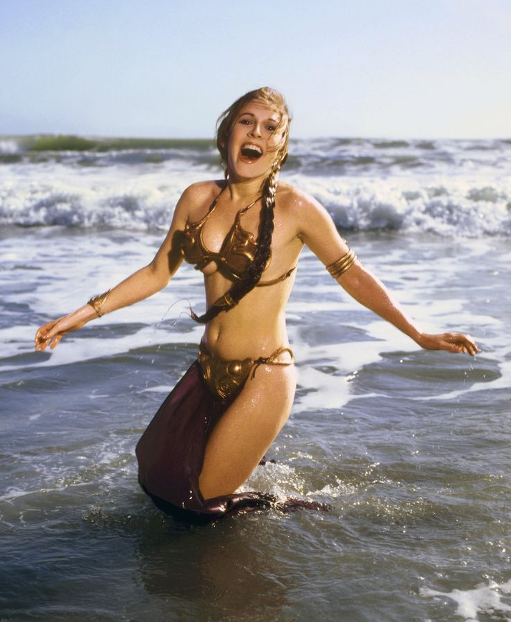 CARRIE FISHER 1983: The gold bikini at the beach, because that makes sense