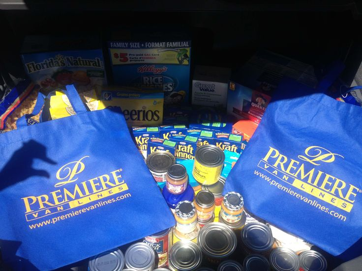 Our Blue Bag proudly poses with food donations collected for a local food bank in Acton, Ontario. Premiere Van Lines employees participated in the event. All together 105 lbs of food products were donated!