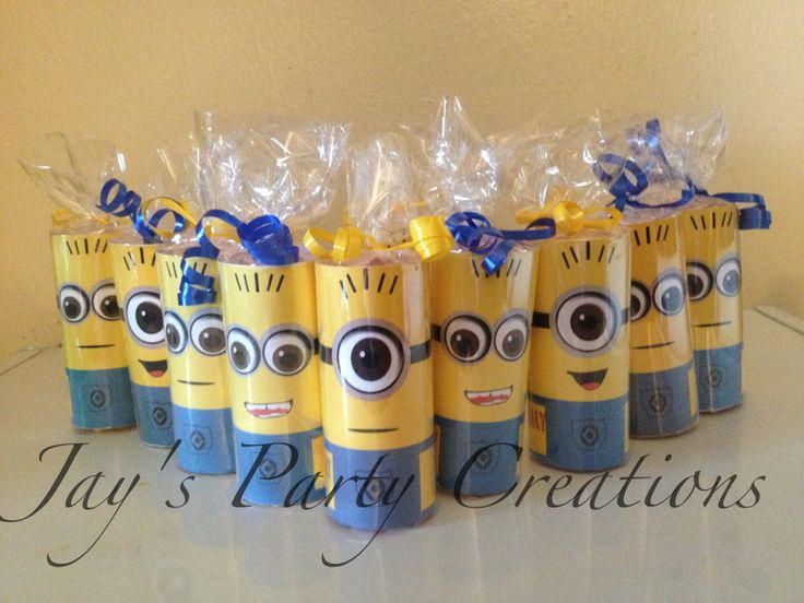 Despicable me party favor candy rolls.  For purchasing info visit my etsy shop @ https://www.etsy.com/shop/CleverCreations112  Or Facebook @: Www.facebook.com/jvpartycreations   Or Instagram @:  Jayspartycreations
