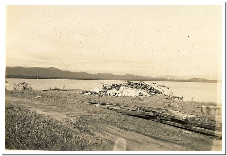 1949 Cooktown Cyclone: Old Timber Shed on broken wharf.