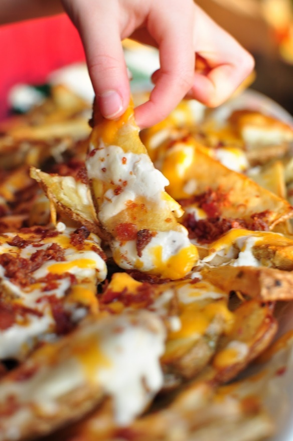 Ooh this looks gooey good!  Cheesy Potato Wedges... 4-6 Potatoes 1/4 c. Olive Oil Sea Salt, Pepper, your favorite Seasoning Salt 1 c. Sour Cream 1/2 c. Ranch Dressing 1/4 c. Milk 1 c. shredded Cheddar 1/2 c. shredded Mozzarella 1/2 c. Real Bacon Bits 1/4 c. Green Onions Cut potatoes into steak fries. Place on foiled baking sheet. Drizzle with oil. Lightly toss with tongs. Sprinkle seasonings over the potatoes. Bake 400* for 40 min til fork tender.