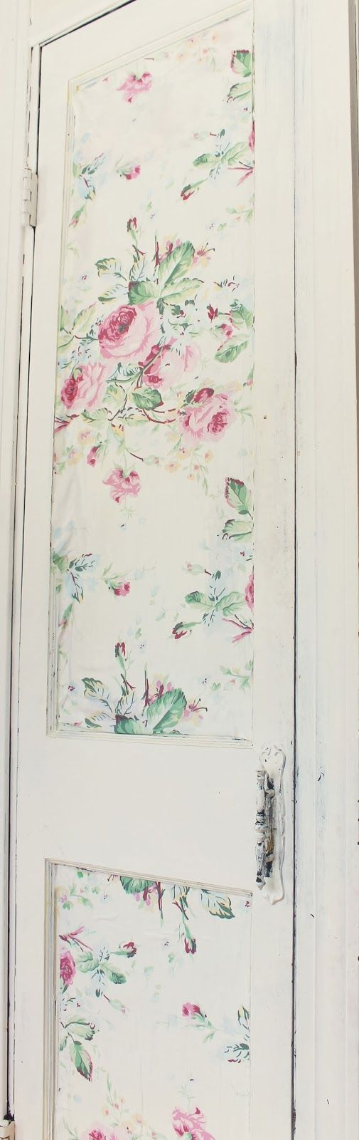 Victoria ModPodged fabric on the door of her pantry.  Trois Petites Filles: Home Goods addiction and fabric wall treatment